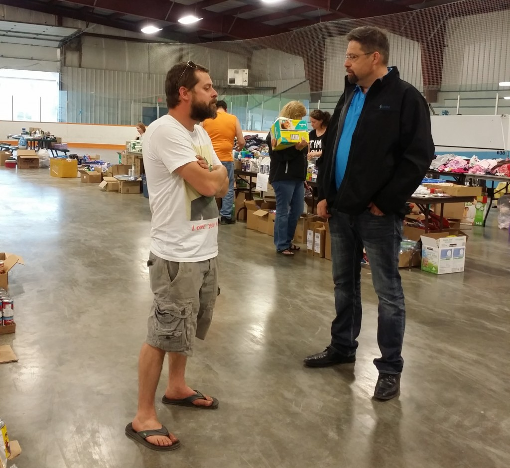 Speaking with evacuees at the Plamondon Bold Centre